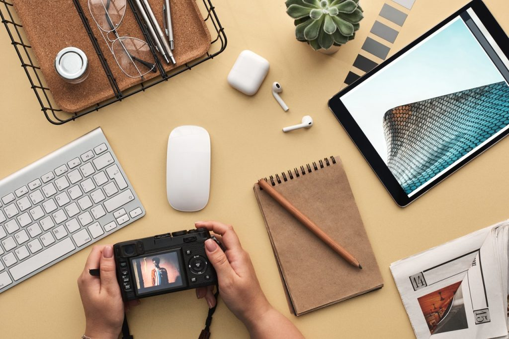 man with camera using technology to boost creativity